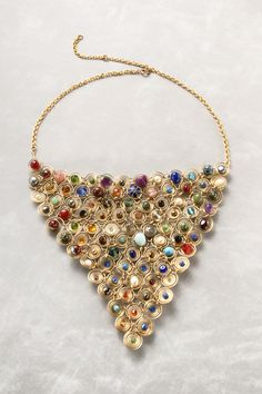 Gold-filled small coiled triangle conatins very small beads and semi precious stones. lovely