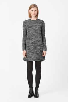 Made from soft wool with a melange finish, this comfortable knitted dress has a soft nappa leather trim around the neck and hem. Fitted at the shoulders, it is a relaxed style with long sleeves, ribbed cuffs and a metal zip fastening along the back.