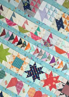 Take a look back at all our 2015 Bitty Blocks and see the quilt top our managing editor Paula Stoddard made using these adorable little quilt block designs! #qmbittyblocks