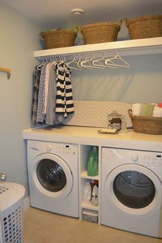 laundry room storage design ideas (shelf between washer + dryer, counter just above, hang drying rod over counter)