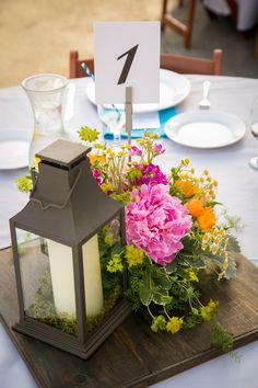 Lantern and floral centerpiece holds a graphic table number {Photo by A. Blake Photography via Project Wedding}