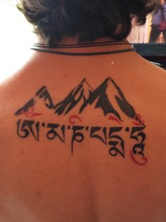 "Mountain back tattoo Tibetan  Om Mani Padme Hum  Mani Padme Hum. A Buddhist mantra that roughly translates to, ""Behold! The jewel in the lotus!"" The symbols are letters of the Tibetan alphabet. From left to right, each syllable purifies you from pride, jealousy, desire, prejudice, possessiveness, and hatred."