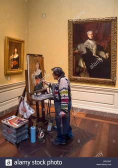 Working at easel in the National Gallery of Art in Washington D.C., a Hispanic art student paints a copy of John Singer Sargent Stock Photo