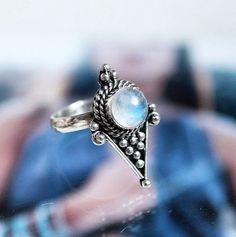 Shop Dixi Crux magical rainbow moonstone set in sterling silver from their A/W Supernova collection.