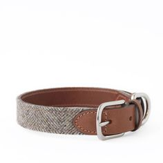 Handcrafted in England, this collar is made with 100% wool tweed that is spun in Yorkshire, Bruccatio leather sourced from Italy, and nickel plated solid brass fittings. Leather is stitched, edge-stai