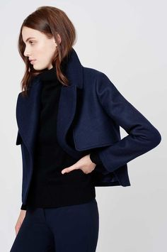 The chic cropped coat gets a fresh point of view in structured heavyweight wool. Crafted in Italy, this piece features heritage details like gun flaps and a back storm shield that are accentuated for a statement silhouette. The oversized lapels finish the design with sophistication, exposing a versatility of styling options. Let it fall perfectly over anything in your closet.