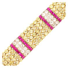 BLACK, STARR & FROST Rare Art Deco Colored Diamond Ruby Diamond Bracelet  USA  Circa 1925  What sets this unique Art Deco bracelet apart from the rest is the unusual bold color combination of yellow diamond, pinkish red rubies and white diamonds.