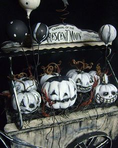 This is a great idea to do with thrift store pumpkins-paint them white and dry brush their faces and details with black paint