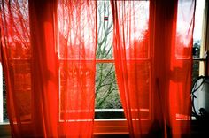 pretty breezy red curtains, these would be good for a little window nook with a bench