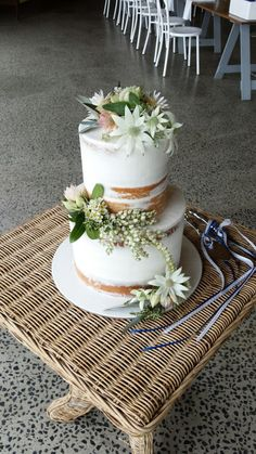 Semi naked wedding cake dressed with beautiful native flowers. #weddingcake #cakeflowers #nakedcake #natives #australiannatives #delicate #pastel #countrywedding #countrystyle