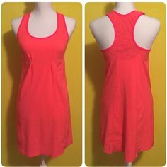 Lululemon run dress Lululemon dress, size 4, excellent condition with no signs of wear or flaws, pretty coral pink color, cute cut out detail on back, reflective detail on it as well(some pics are with the flash on so you can see where it's reflective), great dress, bundle to save ❤️ lululemon athletica Dresses