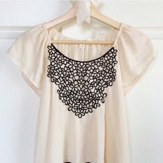 Cream High Low Blouse w/ Black Stitch Overlay Pretty cream high-low blouse with black stitched floral design overlay and flutter sleeves. Worn once or twice, in very good condition. Very flowy, a little bit sheer. Francesca's Collections Tops Blouses