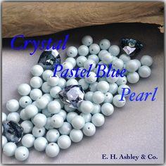 Swarovski's Crystal Pastel Blue Pearl #5810 and Mystique Custom Coating on Swarovski #4706 Trillaint  at www.ehashley.com #Swarovski #Pastels #Pearls #Bling #Crystals