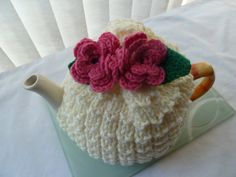 tea cosy cosie hand knitted cream base and pink crochet flowers