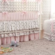 Pink and Gray Chevron Crib Bedding by Carousel Designs.  Ultra feminine ruffles with a contemporary chevron print makes this crib bedding collection a real stand out. Featuring the popular color combination of pink and gray with the added touch of sweet polka dots.