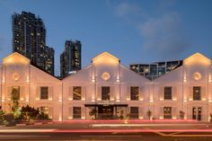 Three warehouses have been combined and outfitted, starting a new lease of life as a 37-room boutique hotel. The Hotel fronts the Singapore River with a distinctive, symmetrical façade and jacked roofs while original design elements like louvre windows, doors, cornices, mouldings and the Chinese characters on the leftmost gable are sensitively retained and restored.