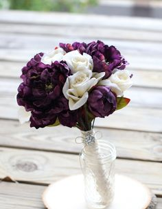 plum bouquet: plum peonies and cream roses - cute but wrapped in burlap or jute and lace instead.