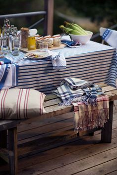 Striped tabelcloth on a rsutic style outdoor table Outdoor Dining, Outdoor Sofa, Outdoor Decor, Nantucket, Les Hamptons, Big Pillows, Lexington Home, Backyard Retreat, Cabins And Cottages