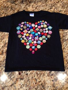 Day of School t-shirt made with 100 random glued on inbloom bead design gems from Hobby Lobby. 100 Day Of School Project, 100 Days Of School, School Projects, School Ideas, 100th Day Tshirt Ideas, 100days Of School Shirt, 100s Day, Kindergarten Projects, School Parties