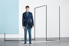 Sharp tailoring is enhanced with a modern leather accessory from the BOSS Menswear pre-Fall 2016 lookbook