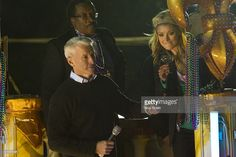 Endymion grand marshals Anderson Cooper and Kelly Ripa toast in front of Gallier Hall in the 2011 Krewe Of Endymion Parade on March 6, 2011 in New Orleans, Louisiana.