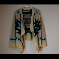 Aztec cream cardigan! This cardigan is covered in an Aztec print and super cute! It's cream based and has a black and baby blue decorating it. It's a size small/medium Sweaters Cardigans