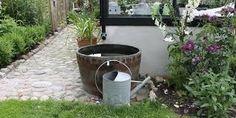 Opsamling af regnvand i tønder
