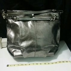 Stunning Large Leather Brooke Hobo Silver Pewter C Xmas Clearance Starting in my closet ^_^♡♡ SUPER PRICE Drop! ! Merry Xmas! ! Excellent condition! #Oneofthekind #Stunning #Large #Leather #Brooke #Hobo #Silver Pewter Clearance! Absolutely #BrandNew Without Tag. Tag wire still on both side of the #silver #brass. Great for any occasion ;). #Coach #Clean interior and exterior #Pewter #Collection! #ISO #hotpick ! #NWOT Rtl:$575. She needs a new home!! Coach Bags Hobos