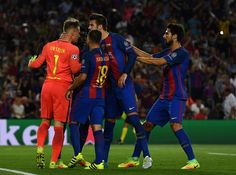 Barcelona players celebrate with Marc-Andre ter Stegen of Barcelona after he saves a penalty from Moussa Dembele of Celtic during the UEFA Champions League Group C match between FC Barcelona and Celtic FC at Camp Nou on September 13, 2016 in Barcelona, Catalonia.