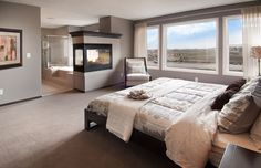 Master Bedroom featuring 3-way gas fireplace in the Everett Showhome, New Brighton