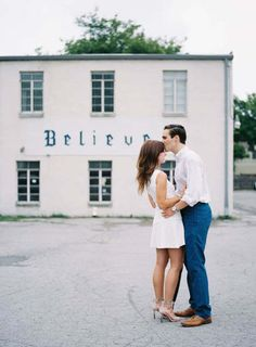 A unique proposal in Nashville; film engagement photos by the 'believe' sign. So romantic!