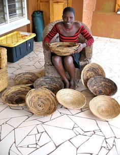 """Rosemary, our partner in Uganda, provides for her entire family at the age of 20.  After the death of her mother and father, she was left to raise her four siblings alone. Rosemary weaves these beautiful baskets by hand out of banana leaves. She uses the income from them to pay for school fees and clothing for her siblings. """"I do not know how to thank you a part from dedicating you to God. May God bless you always"""""""