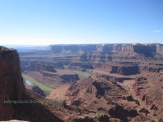 """Dead Horse Point State Park is a state park of Utah, USA, featuring a dramatic overlook of the Colorado River and Canyonlands National Park. The park is so named because of its use as a natural corral by cowboys in the 19th century. The """"dead horse"""" part of the name is that the corral was abandoned, but the horses did not leave the corral, even after the gate was left open, and died there. The park covers 5,362 acres (21.70 km2) of high desert at an altitude of 5,900 feet (1,800 m)."""