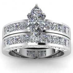 Marquise Shaped Pave Diamond Engagement Ring Wedding Set - A stunning pair comes this 14k White Gold Marquise Shaped Pave Diamond Engagement Ring Wedding Set placed in a Basket, Channel & Pave setting that features a White Marquise center stone with 61 White Princess accent stones on the shank & band. The Marquise Pave set comes with an SI3 in clarity as well as an H in color quality. The total gem weight is equal to 3.0 carats. All of the diamonds are 100% natural. #unusualengagementrings