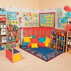 Dr. Seuss reading corner - merchandise available from Oriental Trading Post.  consider cushions and small book covers for wall art?  i also like the alphabet rug for the reading corner.