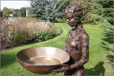 If you or someone you know is really into art statues, this is the perfect bird bath design. This gorgeous bronze statue is roughly cut, bringing all sorts of interesting patterns and textures into play. In her hands sits a large, wide basin perfect for your feathered friends to come and have a bath in. Not only is this just a bird bath, but this piece is truly a work of art.