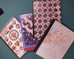straythreads: composition book journals covered with old quilt calendar pages