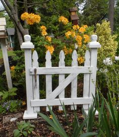 "I thought it would be fun to make a freestanding ""gate"" for out in the garden. Just finished this today and put it in my own flower bed to take a picture. What do you think? I love the old garden tool handle.  https://www.facebook.com/Carlasgardenanddecor"