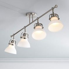 Direct light exactly where you need it with this track fixture featuring adjustable light heads. Style # at Lamps Plus. Bright Kitchen Lighting, Kitchen Lighting Fixtures, Ceiling Light Fixtures, Kitchen Track Lighting, Craft Room Lighting, Salon Lighting, Lighting Ideas, Bathroom Ceiling Light, Kitchen Ceiling Lights