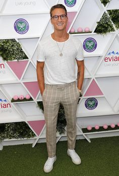 Consider pairing a white crew-neck tee with beige check dress pants for a work-approved look. White leather low top sneakers will contrast beautifully against the rest of the look.