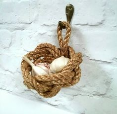 Check out this item in my Etsy shop https://www.etsy.com/uk/listing/509253345/rustic-garlic-basket-small-hanging-rope