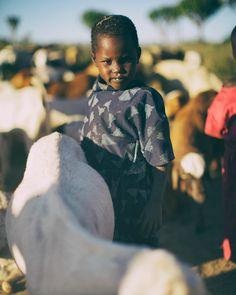 #fbf to Tanzania and this little Maasai girl tending to her herd... . . . . . #traveldeeper #mytinyatlas #gooutside #wandering #whereisjimnow #tanzania #aftica #maasai #nomadic #conqueroroftheuseless #getoutthere #passportready #wanderlust #adventure #livethelifeyoulove #lovethelifeyoulive #neverstopexploring #outdoors #liveauthentic #makeitnice #chasinglight #fromwhereistand #chooseyourownadventure #fuzereps #travelphotography #photography #portrait  #traveller #travelgram