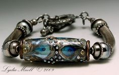Lampwork silvered barrel focal beads.Can't get enough Lydia Muell eye candy!