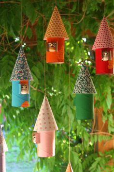 Toilet paper roll bird houses http://kiflieslevendula.blogspot.be/search?updated-max=2012-06-06T05:13:00%2B02:00=7=27=false  Toilet paper rolls-paint Cut a window in center  Roof-scrapbook paper?-traced plate for shape/size. Cut one side, roll into cone. Glue. Hang: a string through the roof top to bottom, ended with a bead so it doesn't slip off, then tied both ends to a stick: