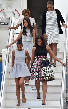 First Lady Michelle Obama with First Daughters Sasha and Malia Obama
