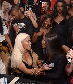 A list friends: Wearing her hair in a sleek centre parting, Naomi was seen mingling with Teyana Taylor as they got in the spirit
