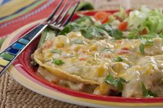 Tortilla Chicken-Pot-Pie -  2 cups diced cooked chicken,     1 medium-sized onion, chopped, 1 medium-sized red bell pepper, chopped, 2 (4-ounce) cans chopped green chilies, drained, 1 (10-1/2-ounce) can condensed cream of mushroom soup, 1 (10-1/2-ounce) can condensed cream of chicken soup, 1 cup milk, 12 corn tortillas, Cooking spray, 3 cups (12 ounces) shredded Mexican cheese blend - 350 degrees F.