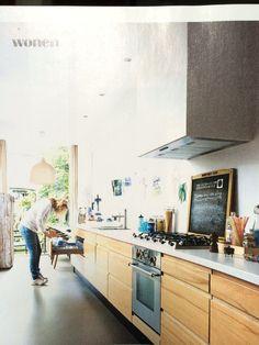 Wooden kitchen cabinets, white worktop, drawers