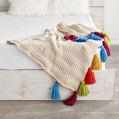 Mix up the style of our Caron One Pound Crochet Tasseled Throw by changing up up the color scheme! Follow the link in the bio for the free pattern!