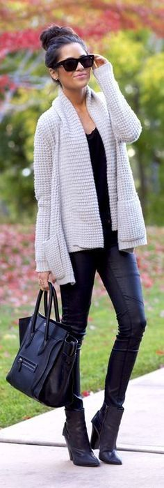Chunky cream sweater over all black outfit... black statement sunnies, messy bun and light pink lip, YES PLEASE!
